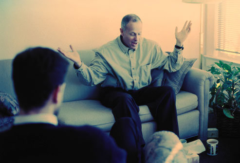 getty_rf_photo_of_man_in_therapy_session_gesturing